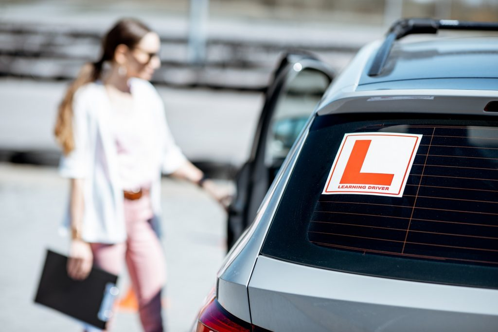 Learning sign on the car with female driver